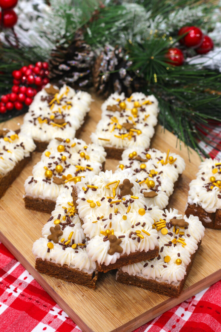 These festive gingerbread bars are frosted with a scrumptious cream cheese frosting that perfectly balances out the spiced sweetness of the bar.