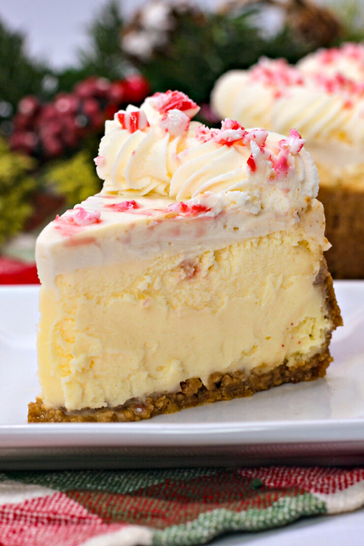 This peppermint white chocolate cheesecake gets topped with crushed candy canes and a sour cream topping to create a showstopping dessert.