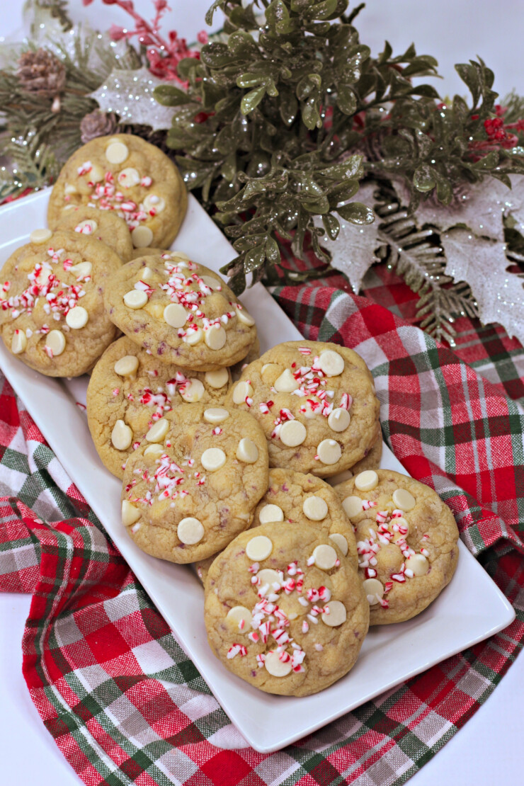 Tender chocolate chip cookies get a festive makeover with these White Chocolate Candy Cane Cookies, an easy Christmas cookie recipe.