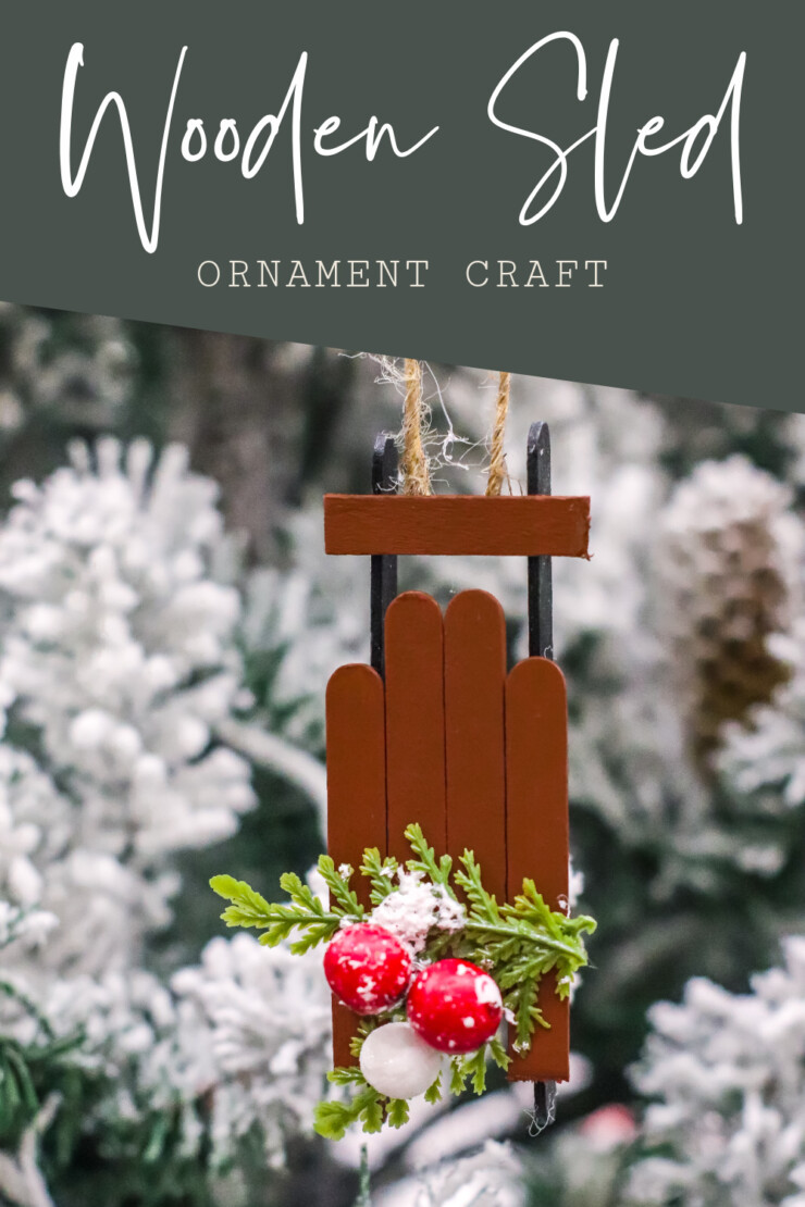 This Wooden Sled Ornament Craft is made with craft sticks and a few other basic supplies for an adorable Christmas tree ornament.
