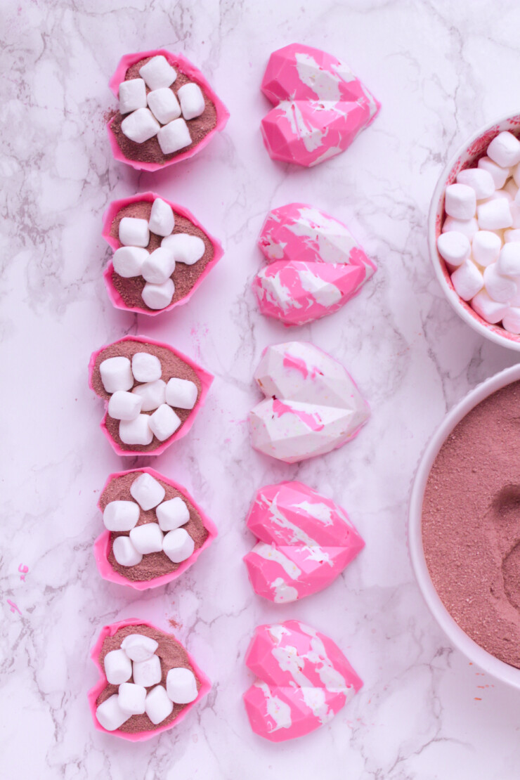 These geometric heart hot chocolate bombs are a fun and trendy Valentine's Day treat for kids, featuring pink hot cocoa with Marshmallows.