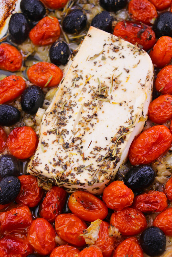 Feta baked in herbs with cherry tomatoes and olives.