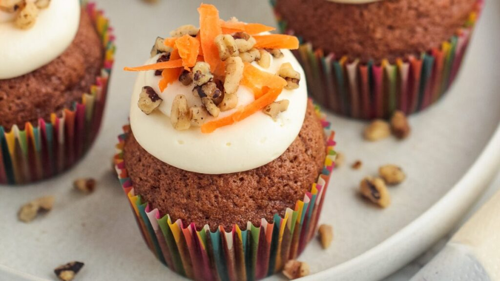 These easy carrot cake cupcakes are soft, moist, and slightly spiced.  They are simply delicious when topped with homemade cream cheese frosting!