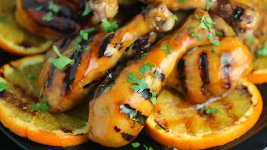 Marinated and grilled in a scotch bonnet and orange glaze, these chicken drumsticks are perfectly sweet and spicy.