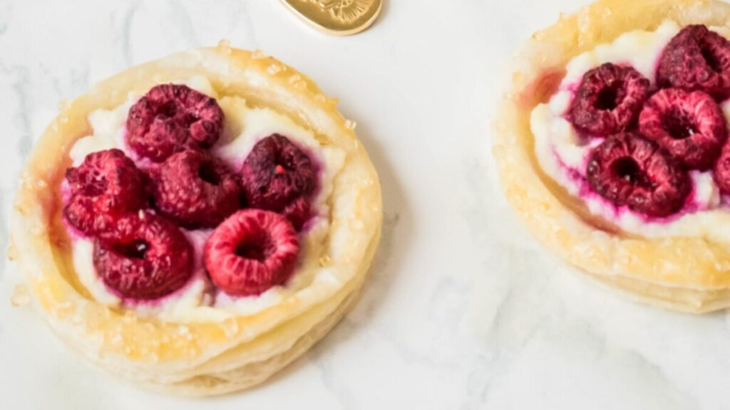 These Puff Pastry Raspberry Danishes are an easy to make breakfast pastry featuring puff pastry, fresh raspberries and a luscious ricotta filling.