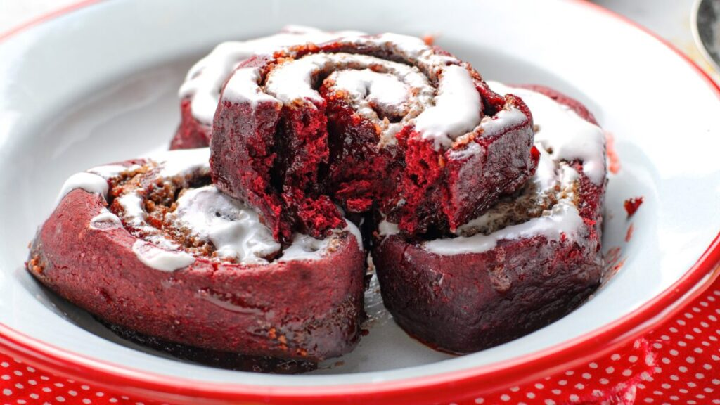 These red velvet cinnamon rolls are delicious, tender, oh so decadent. Turn a box of red velvet cake mix into this stunning dessert! Perfect for a Valentine's Day treat.