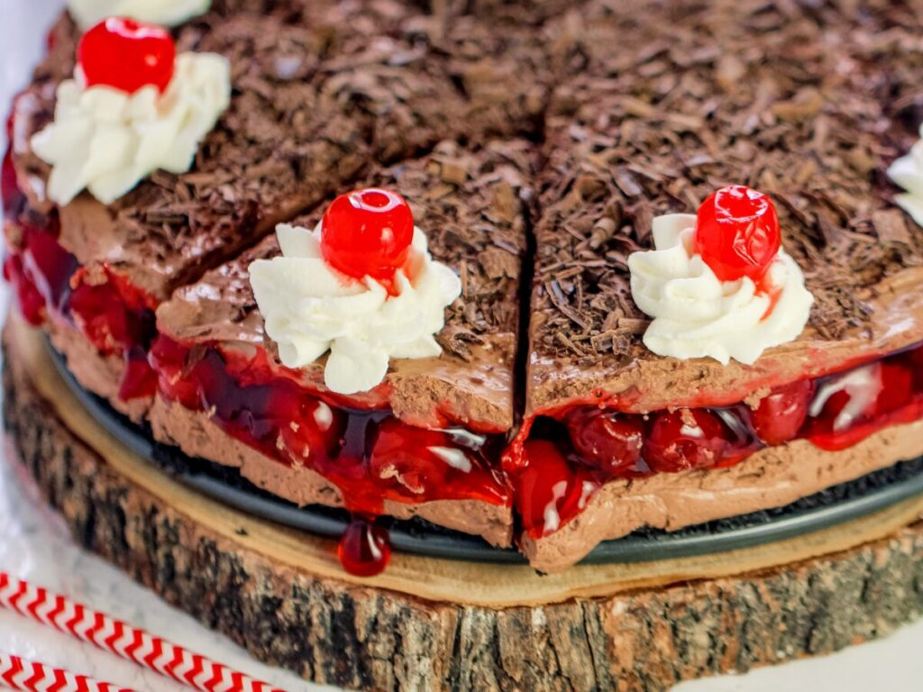 This No-Bake Black Forest Cheesecake features cherry pie filling between layers of creamy and light chocolate cheesecake filling.