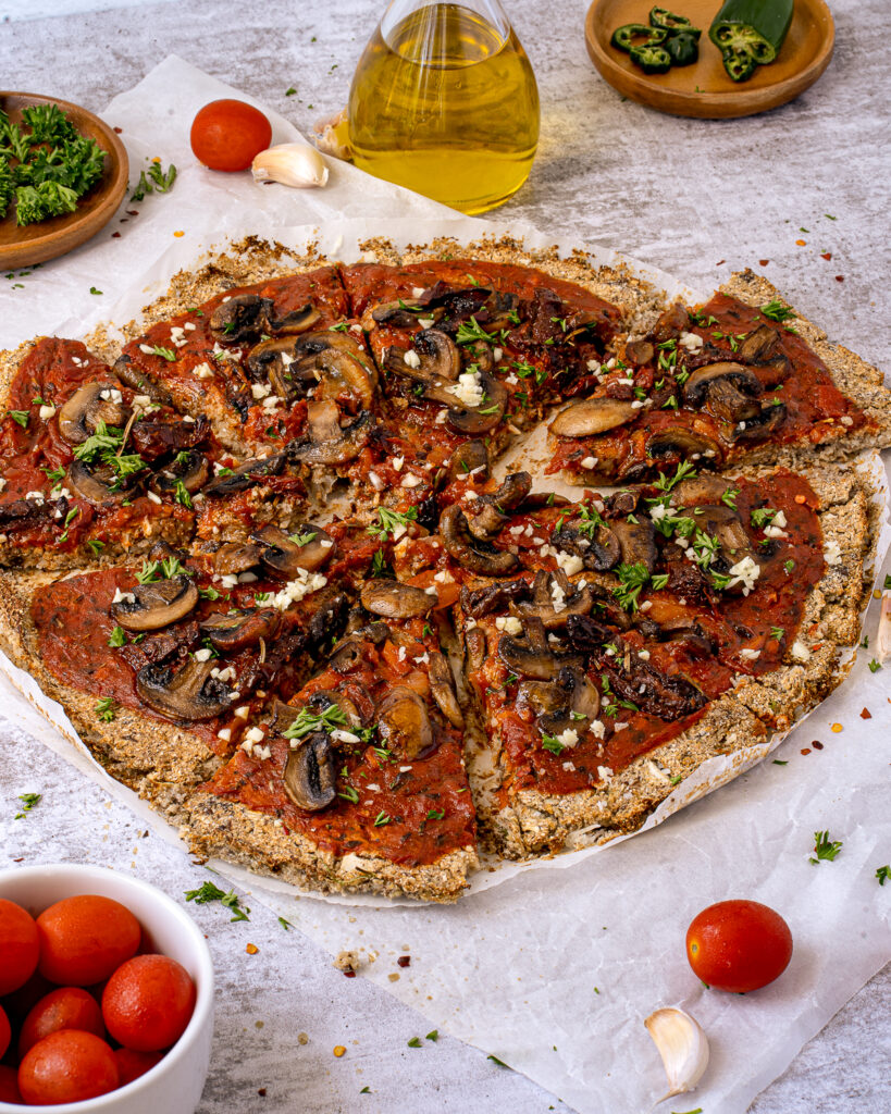 This Vegan Cauliflower Crust Pizza with Mushrooms is gluten-free, low carb, and has the best taste and texture.