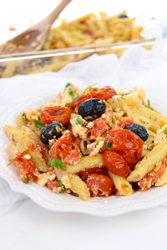 This Baked Feta Pasta with Cherry Tomatoes recipe is inspired by the TikTok famous cherry tomato pasta recipe. It's easy and delicious!