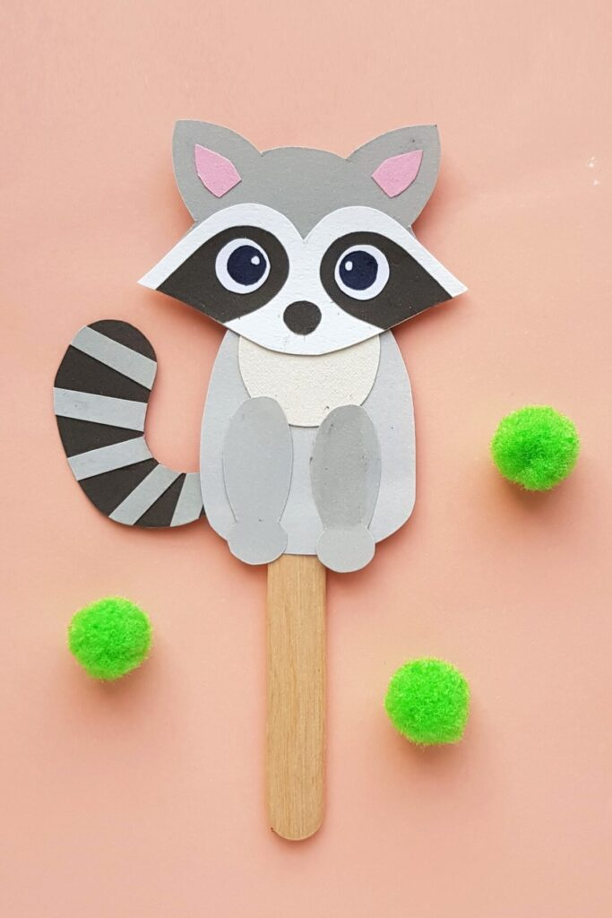 This Papercraft Raccoon Puppet is an easy kids paperfcraft animal project with a free papercraft template to help you make this kids craft.