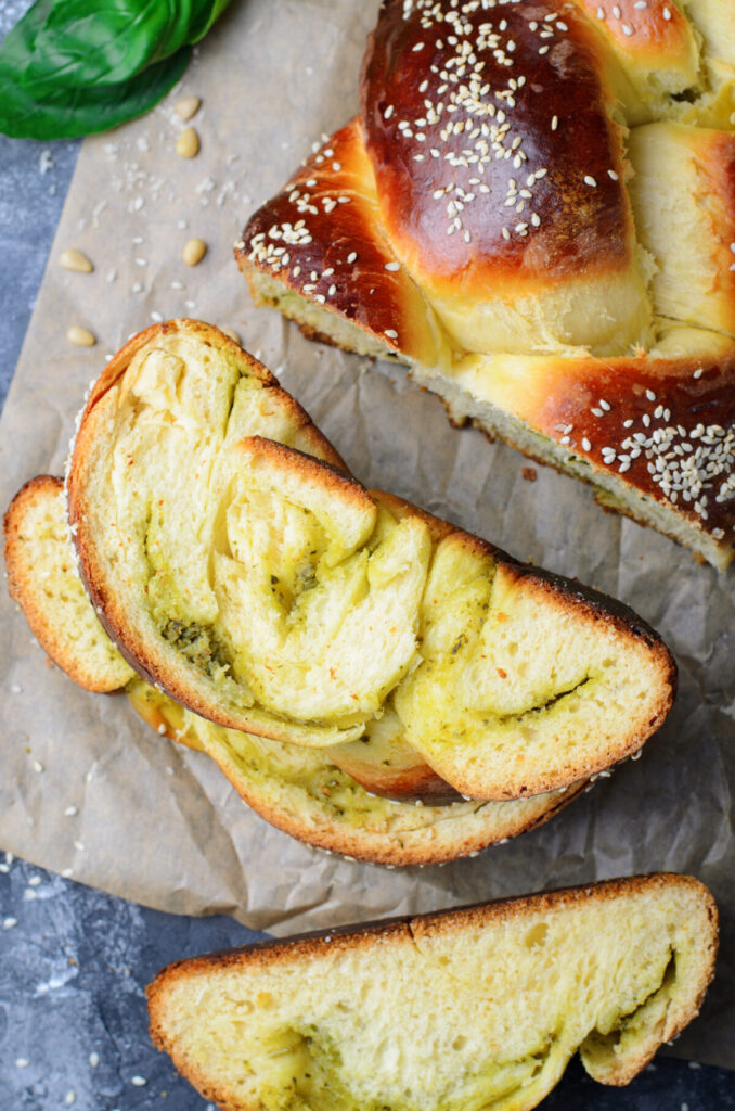 This Parmesan Pesto Challah Bread recipe makes a braided loaf that is light & fluffy with a golden crust, filled with swirls of pesto.