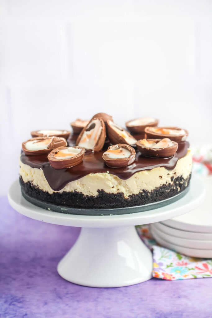 This Instant Pot Creme Egg Cheesecake is an easy Easter dessert; rich vanilla cheesecake smothered in chocolate ganache & SO MANY CREME EGGS!