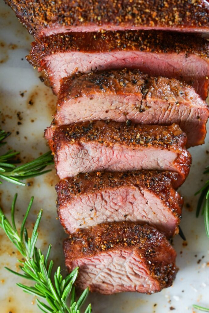 Smoked Tri-Tip is flavourful, juicy, and melt in your mouth tender. Make the best beef tip roast on any type of smoker with this easy recipe!
