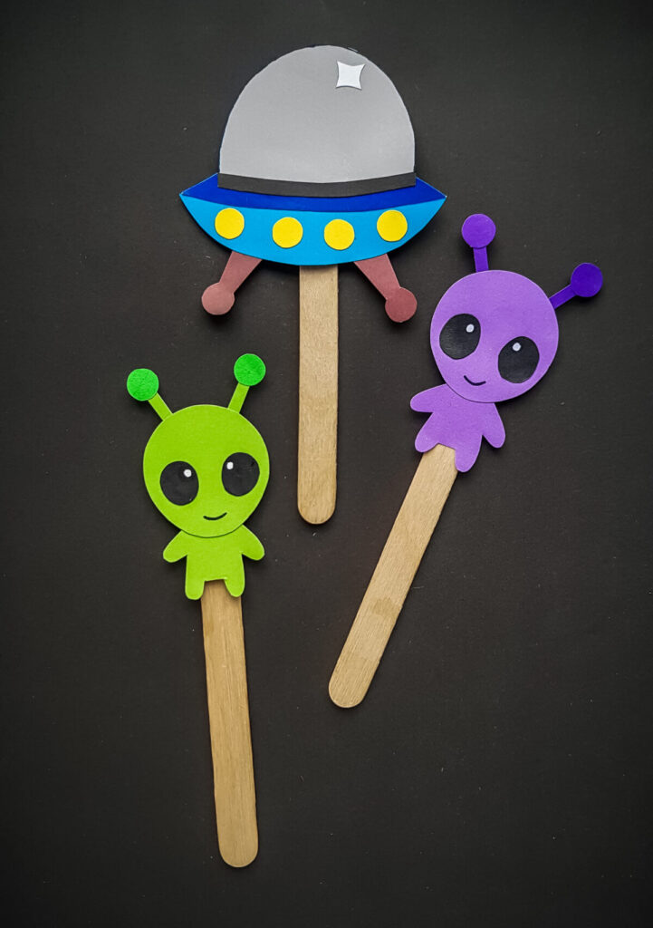 These Papercraft Alien Craft Stick Puppets are made easy with a free papercraft template to help you make this kids craft.