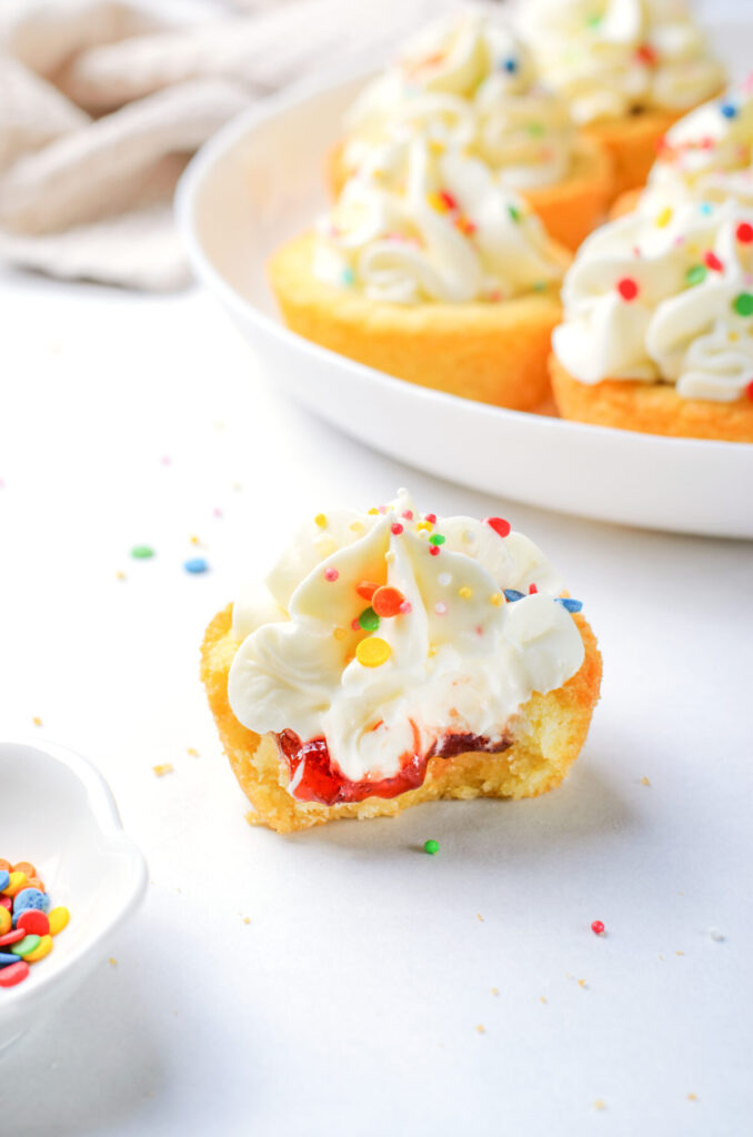 Super easy and delicious, these strawberry cheesecake cookie cups are the perfect treat to dig into when you're hit by a sweet craving!