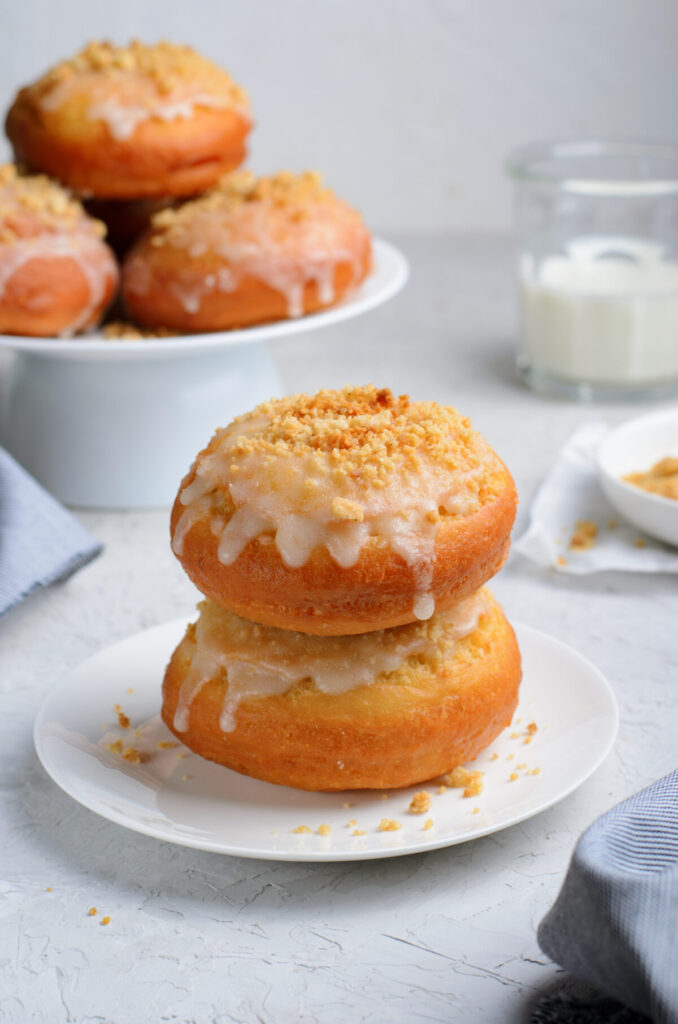 Dulce De Leche Donuts featuring a buttery tender dough that is stuffed with dulce de leche and fried up into a golden, fluffy masterpiece.