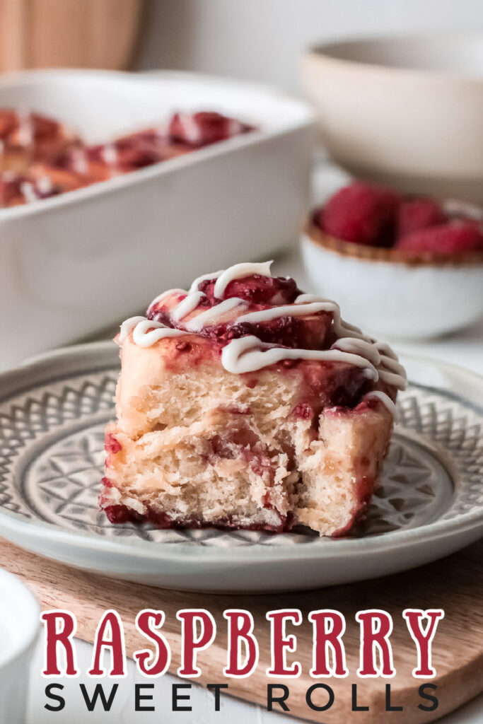 Raspberry Sweet Rolls - soft, fluffy and sweet yeast rolls filled with raspberries and smothered with cream cheese frosting.