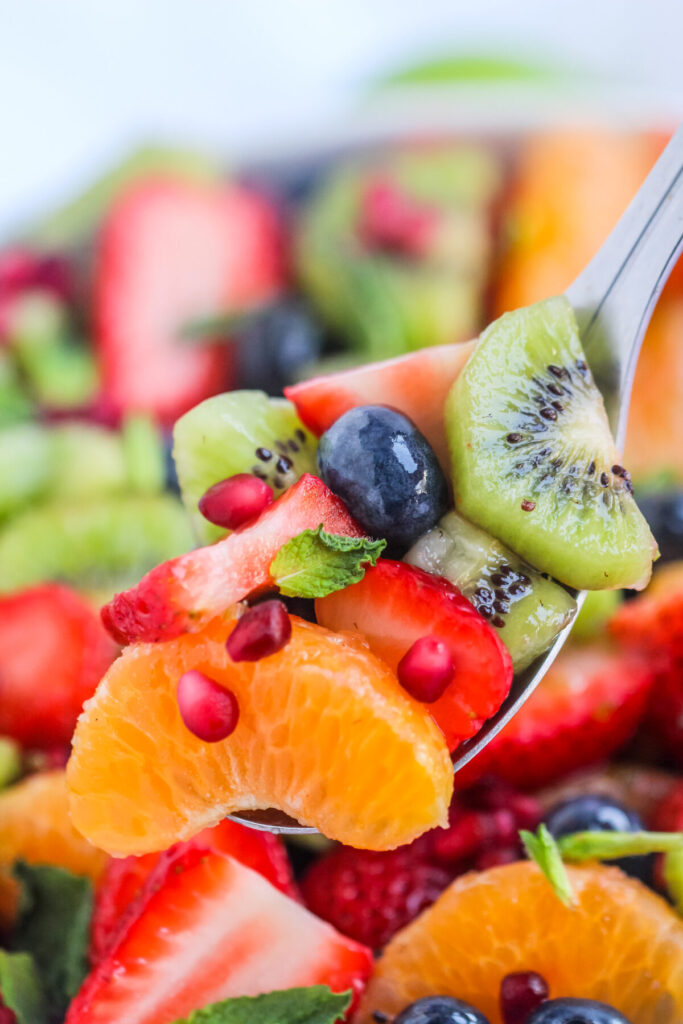 Honey Lime Fruit Salad is made with seasonal fruit and tossed in a fresh lime and honey dressing for a crowd-pleasing summer salad.