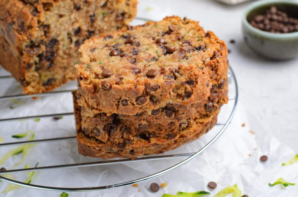 The BEST Chocolate Chip Zucchini Bread Recipe ever! Super moist, soft, and loaded with chocolate chips; it's a tasty way to use up zucchini.