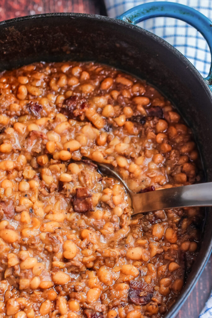 The BEST Homemade Cowboy baked beans recipe with step by step instructions for baking in the oven, in your crock pot, or over the campfire.