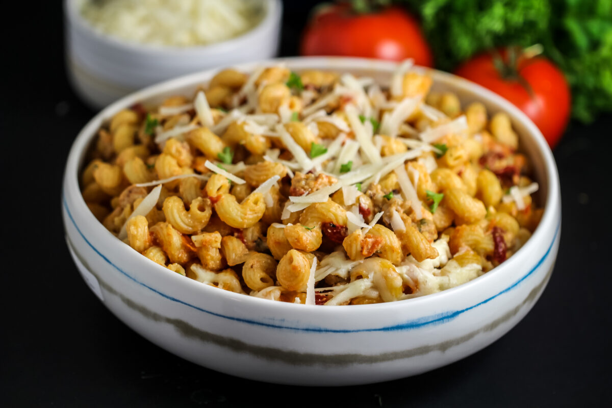 When the weather begins to turn cold, snuggle up with this cozy & Creamy Cavatappi Pasta with Italian Sausage. It's a tasty family dinner.