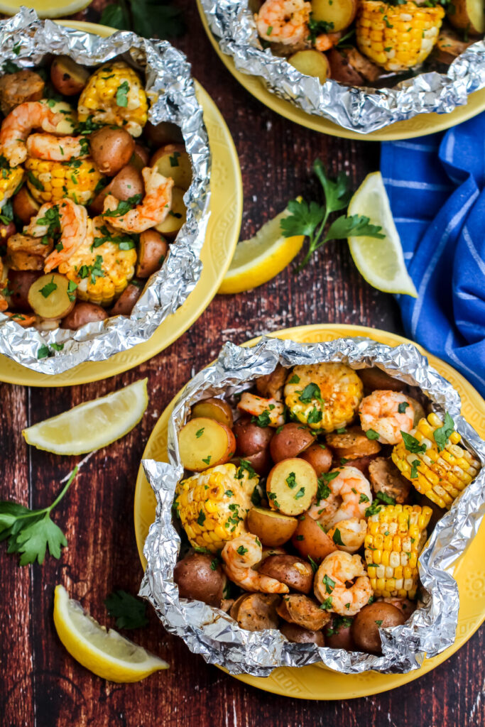 Cook these Shrimp Boil Foil Packets over a campfire, on the grill or in your oven for an easy family dinner with almost no cleanup!
