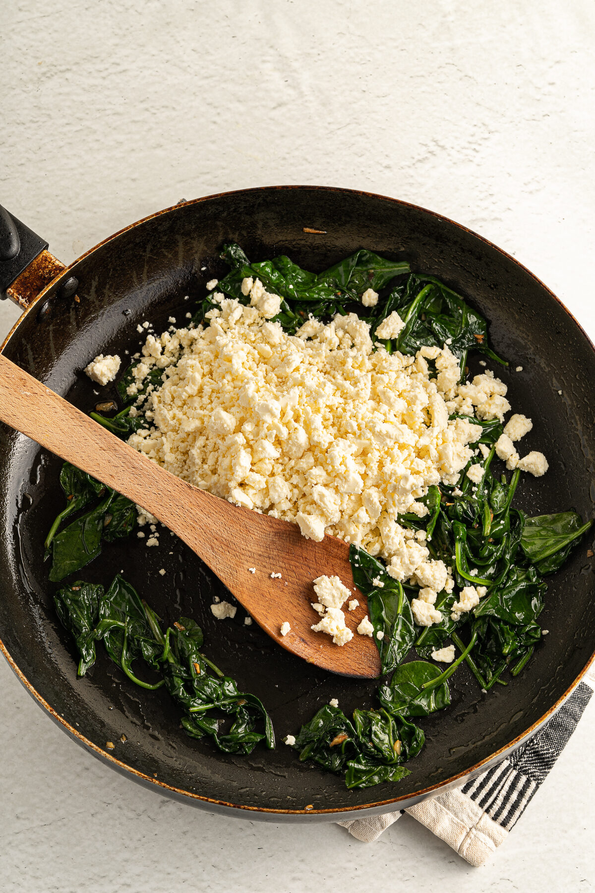 Cheese and spinach in a pan