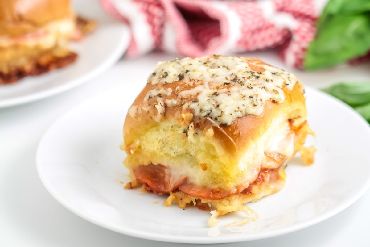 Pepperoni Pizza Sliders are the perfect party food! They're simple to make and everyone will love them. They make for a tasty lunch too!