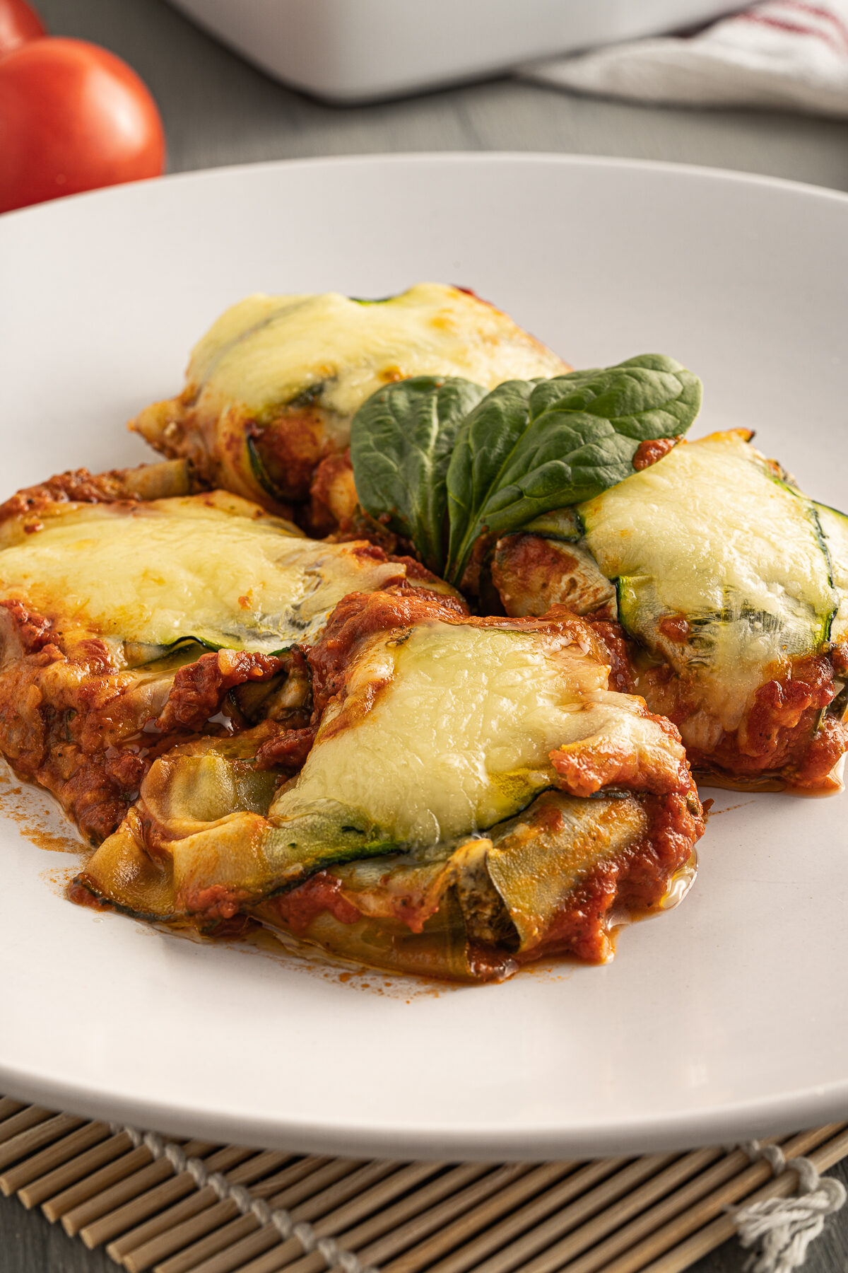 Zucchini ravioli is an easy to make Keto friendly family meal. Filled with cheese and spinach, it's a satisfying & tasty vegetarian dish!
