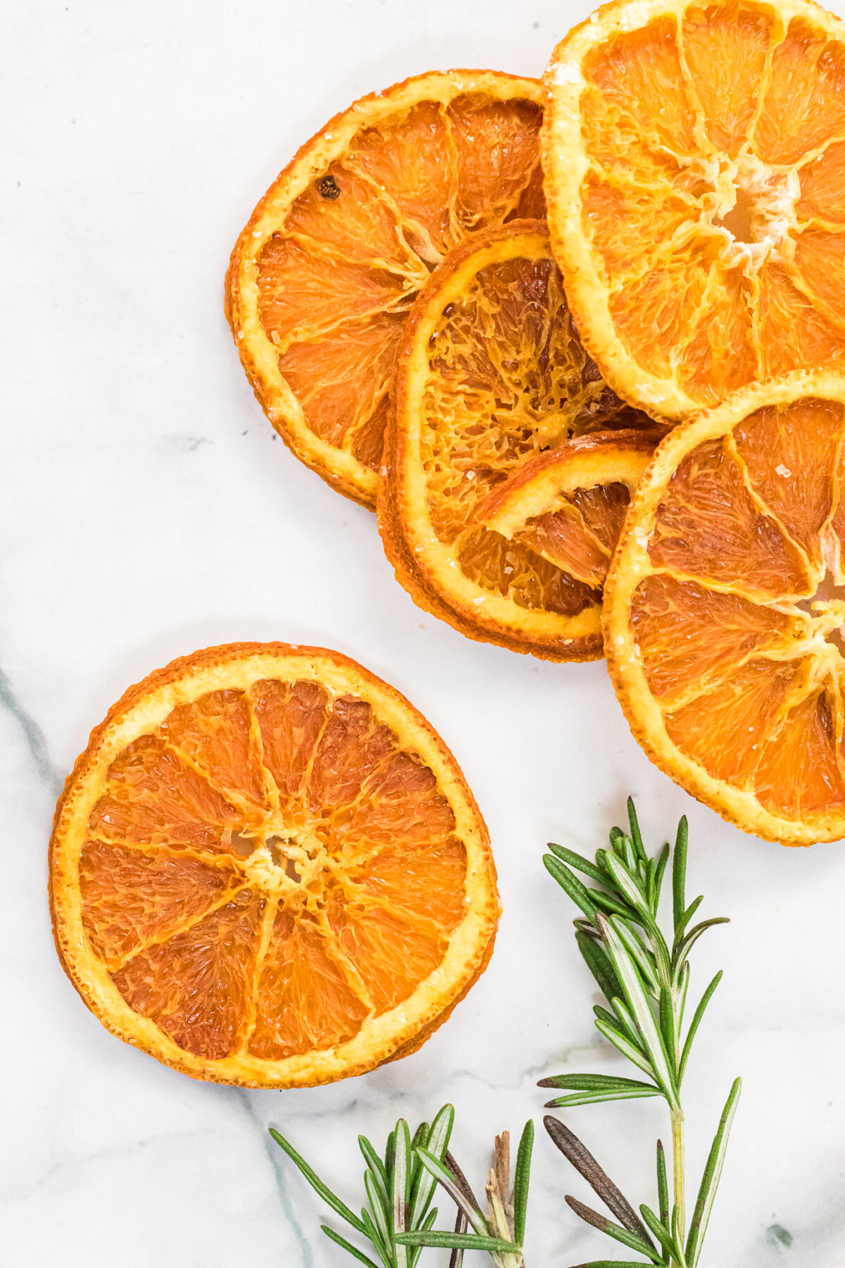 An excellent way to preserve oranges, dried orange slices can be used for craft projects, drink garnishes, or snacking.