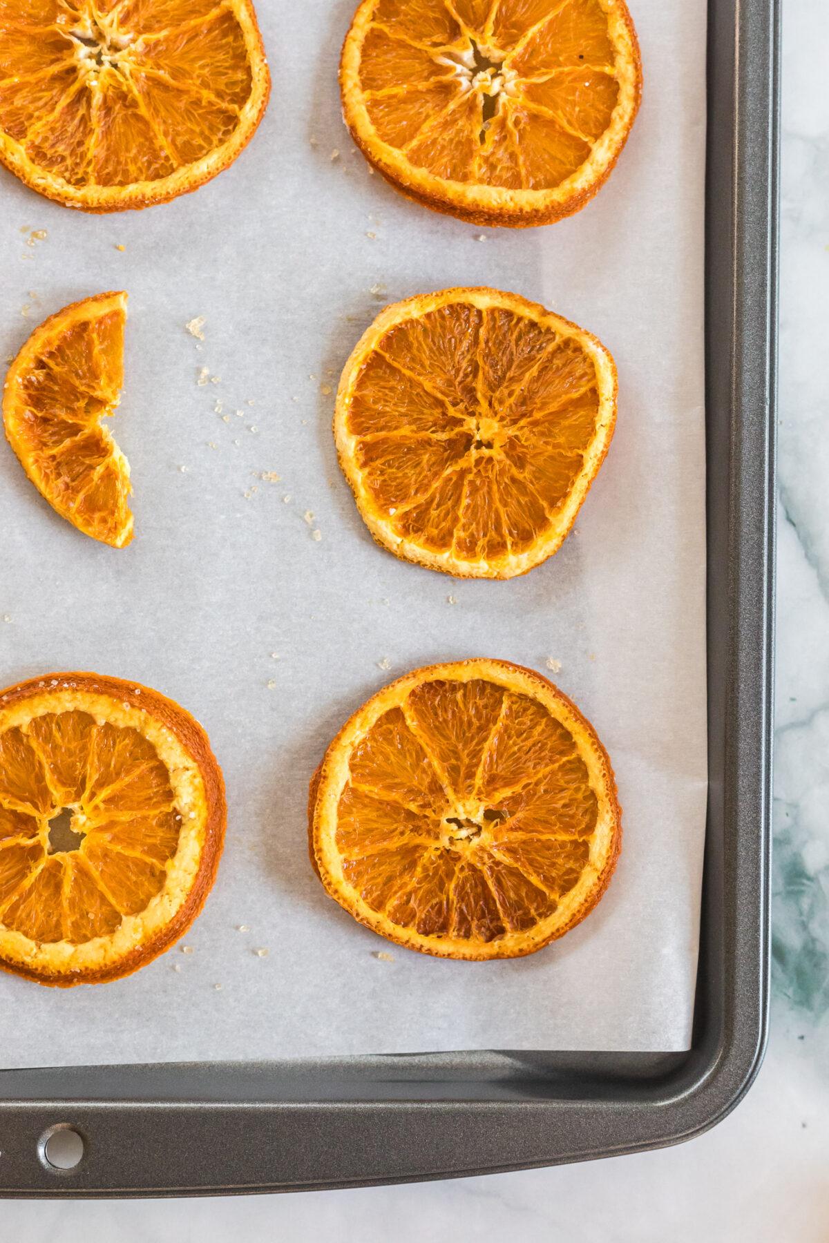 Dried orange slices on baking sheet