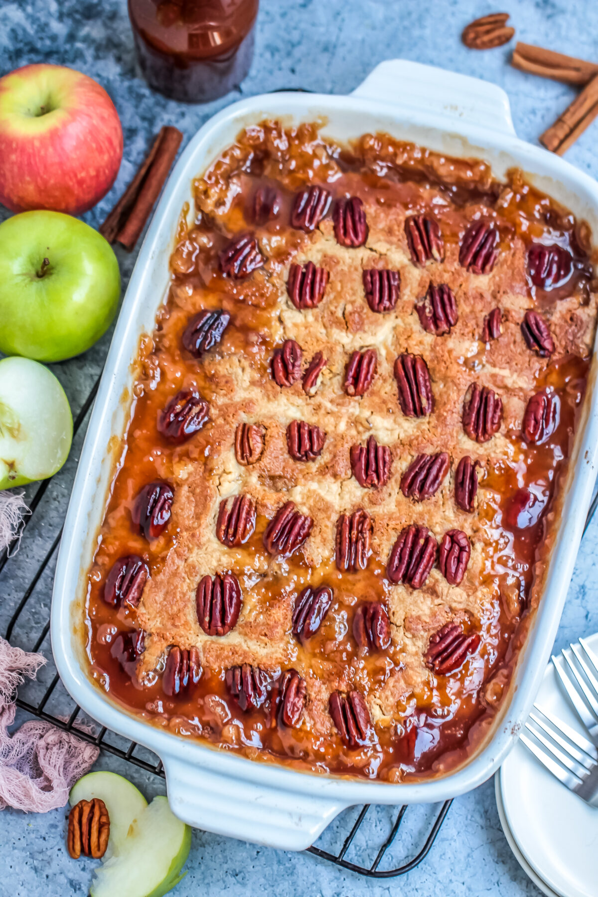 A delicious apple dump cake recipe that is easy to prepare and makes a great fall dessert served warm with ice cream and caramel sauce!