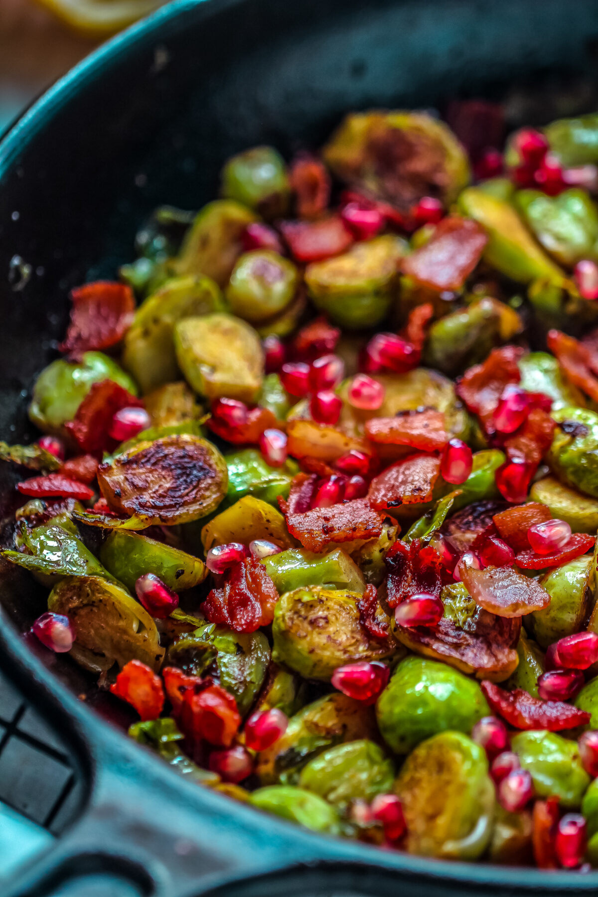 Pan Roasted Brussels Sprouts with Bacon & Pomegranate makes for a tasty holiday side dish that works just as easily for a weeknight side.