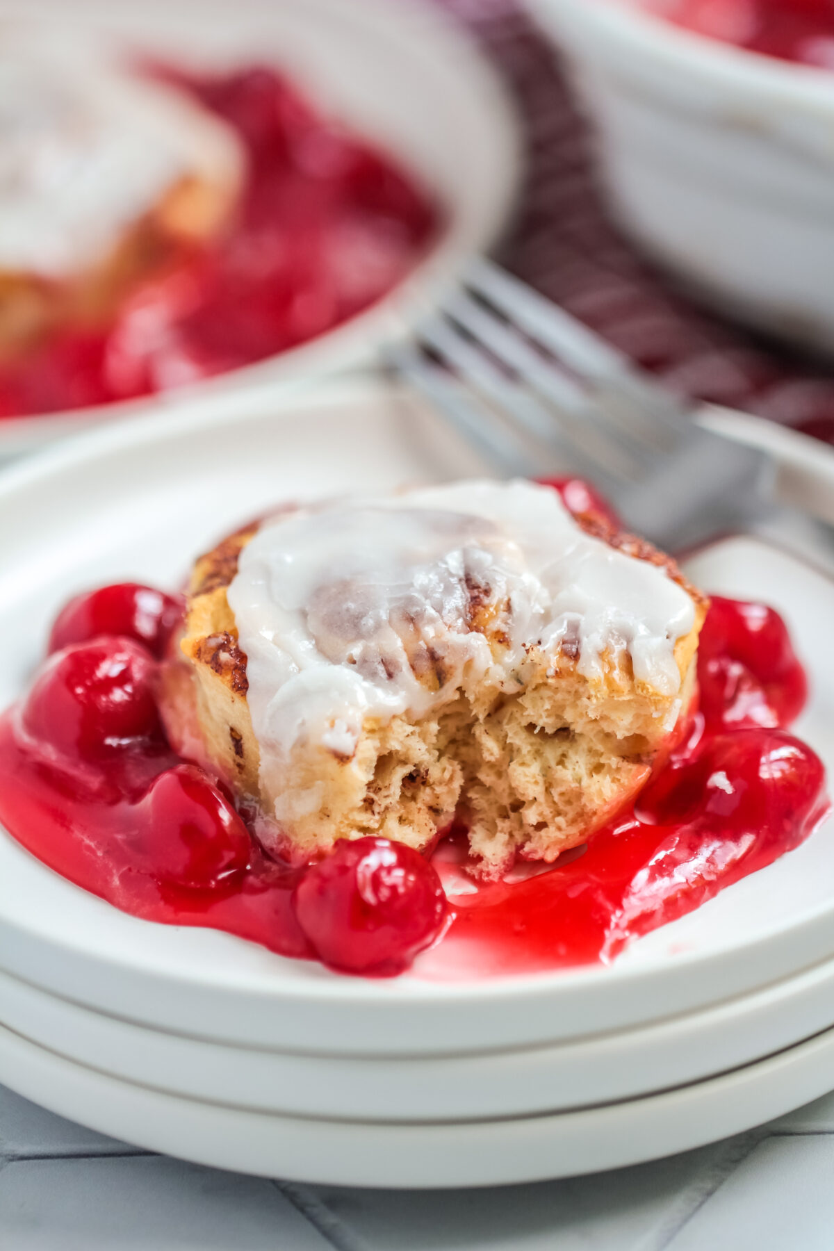 This Cinnamon Roll Cherry Cobbler Recipe uses just two ingredients. Warm and gooey, this easy dessert is perfect for any occasion.