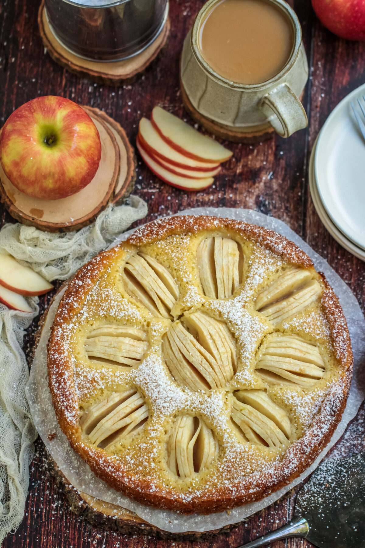 Classic German apple cake, Apfelkuchen, is moist and buttery. It's a simple and rustic cake made with fresh apples - a perfect fall dessert.