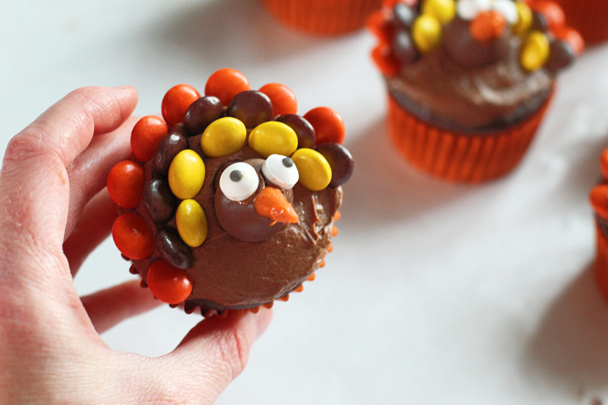 """Small eyes """"glued"""" onto the cupcakes"""