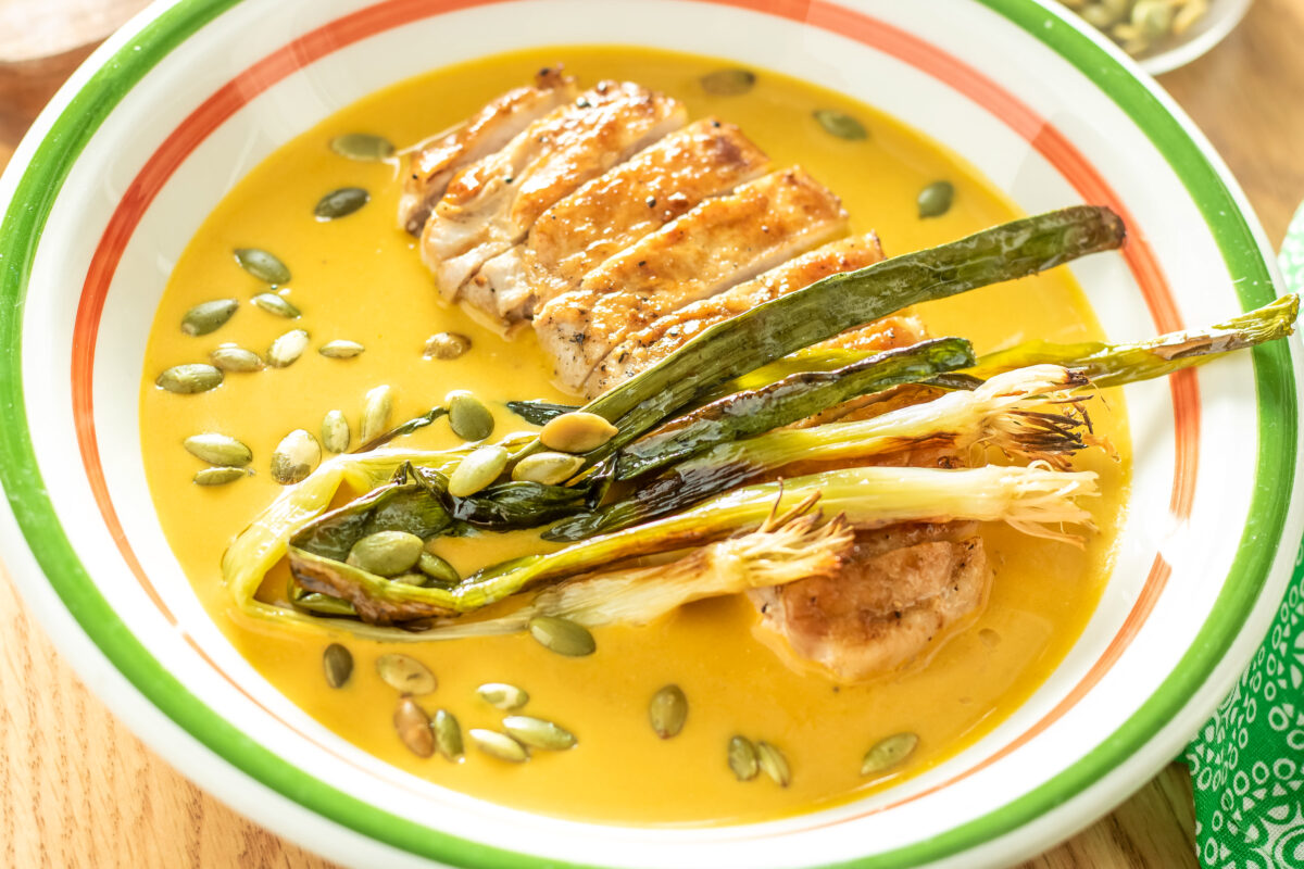 Keep the chill of winter at bay with this hearty Pepita Pork Pumpkin Soup. Creamy pumpkin soup with pan-seared pork loin chops.