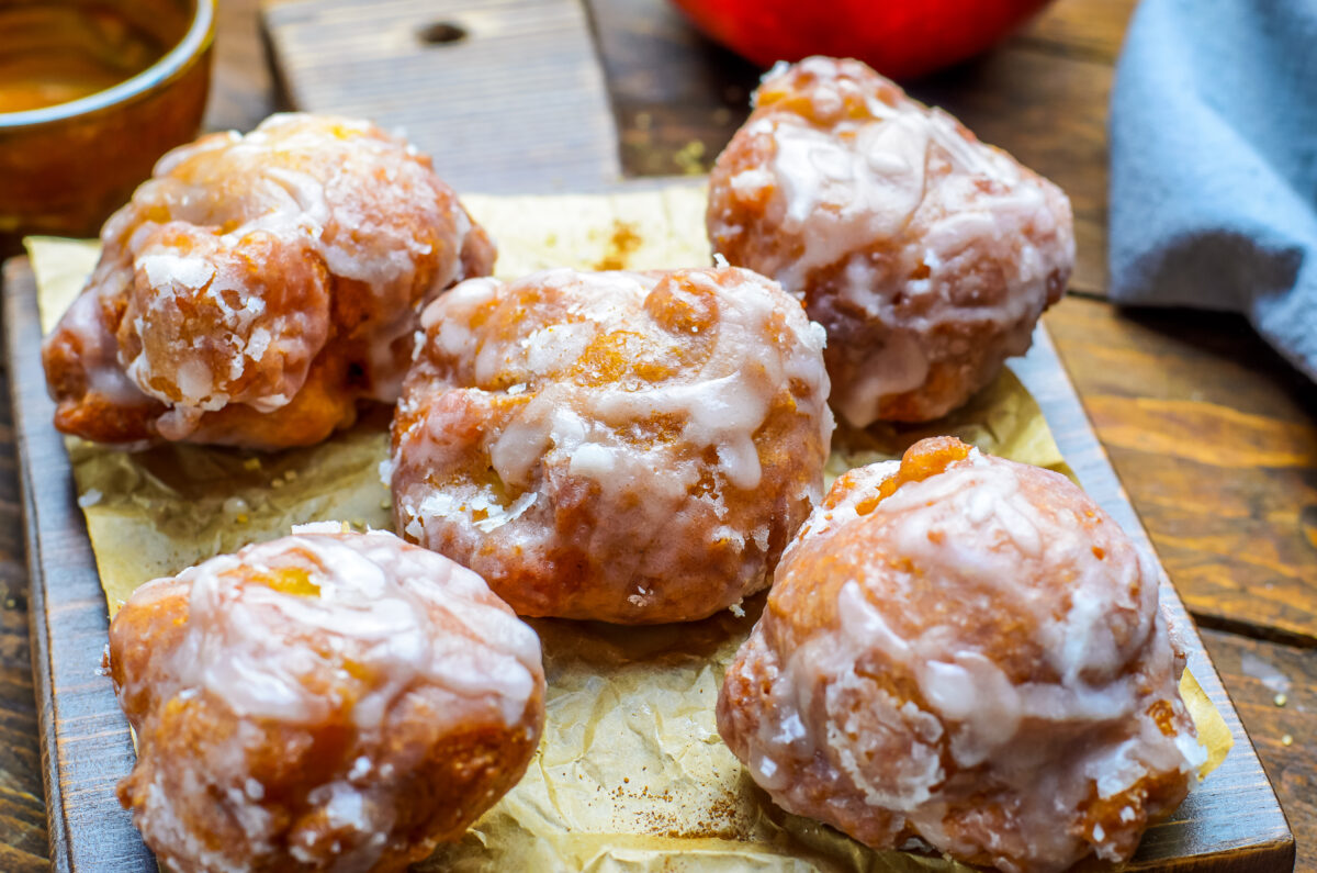 These Old Fashioned Apple Fritters are made with a cakey batter incorporated with juicy apples and glazed. They're an easy-to-make fall treat.