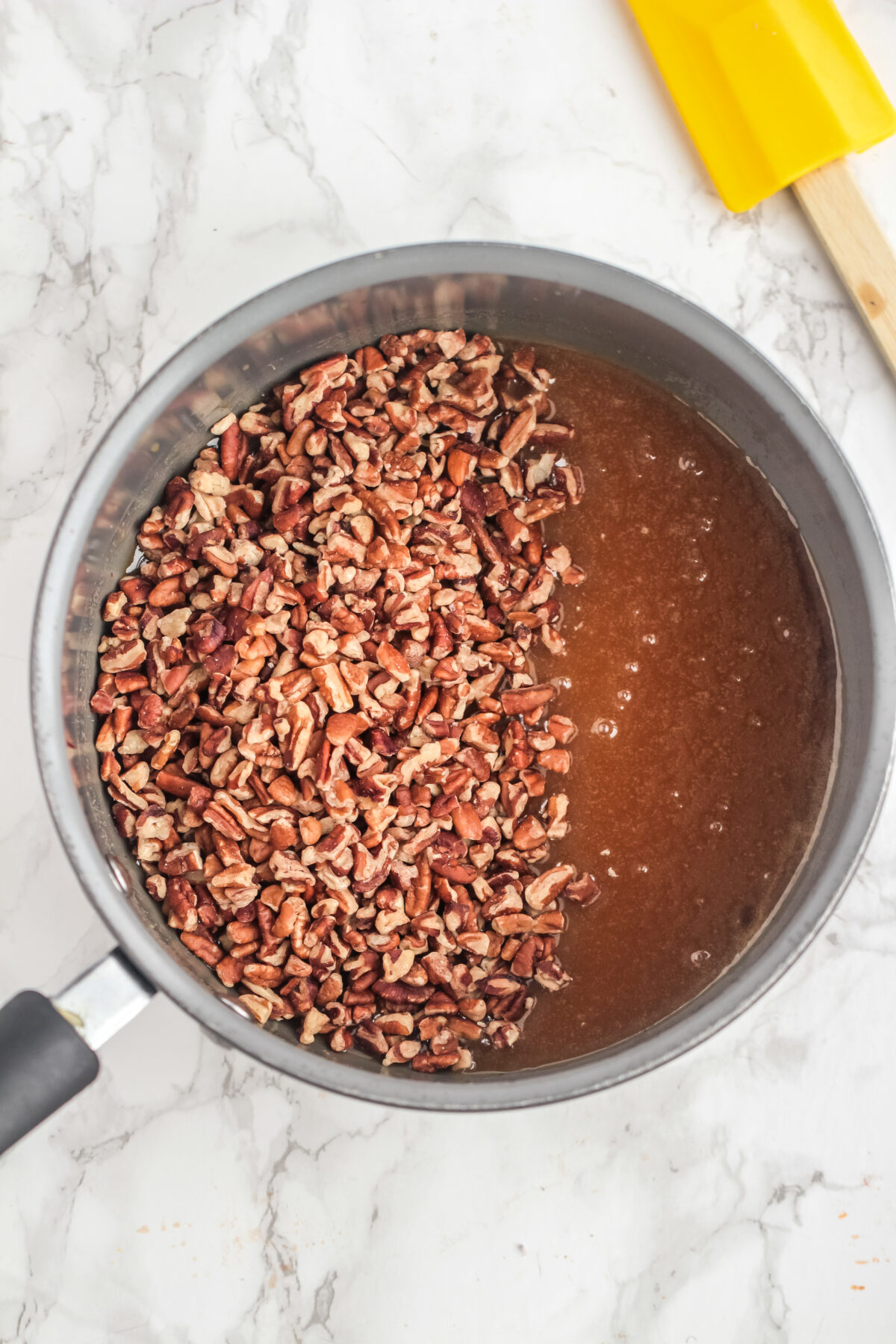 pecans being added to syrup.