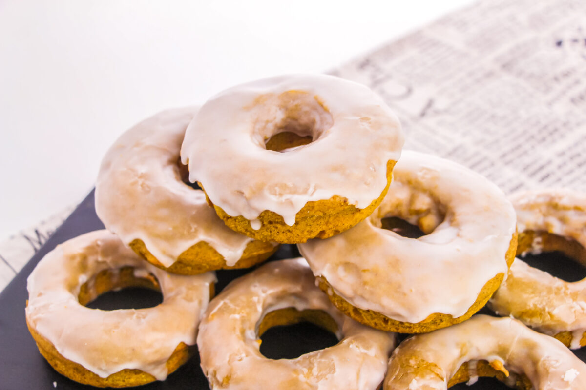 An easy recipe for Baked Pumpkin Donuts that results in soft fluffy and flavourful cake donuts without yeast in just 30 minutes.