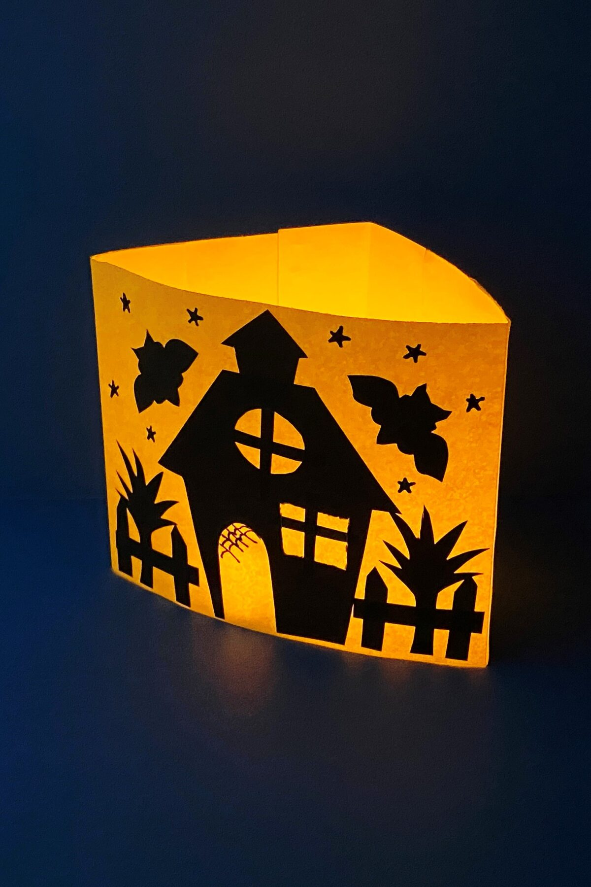 This simple haunted house luminary craft is sure to make a great addition to your Halloween decor, and is a fun and easy kids Halloween craft.