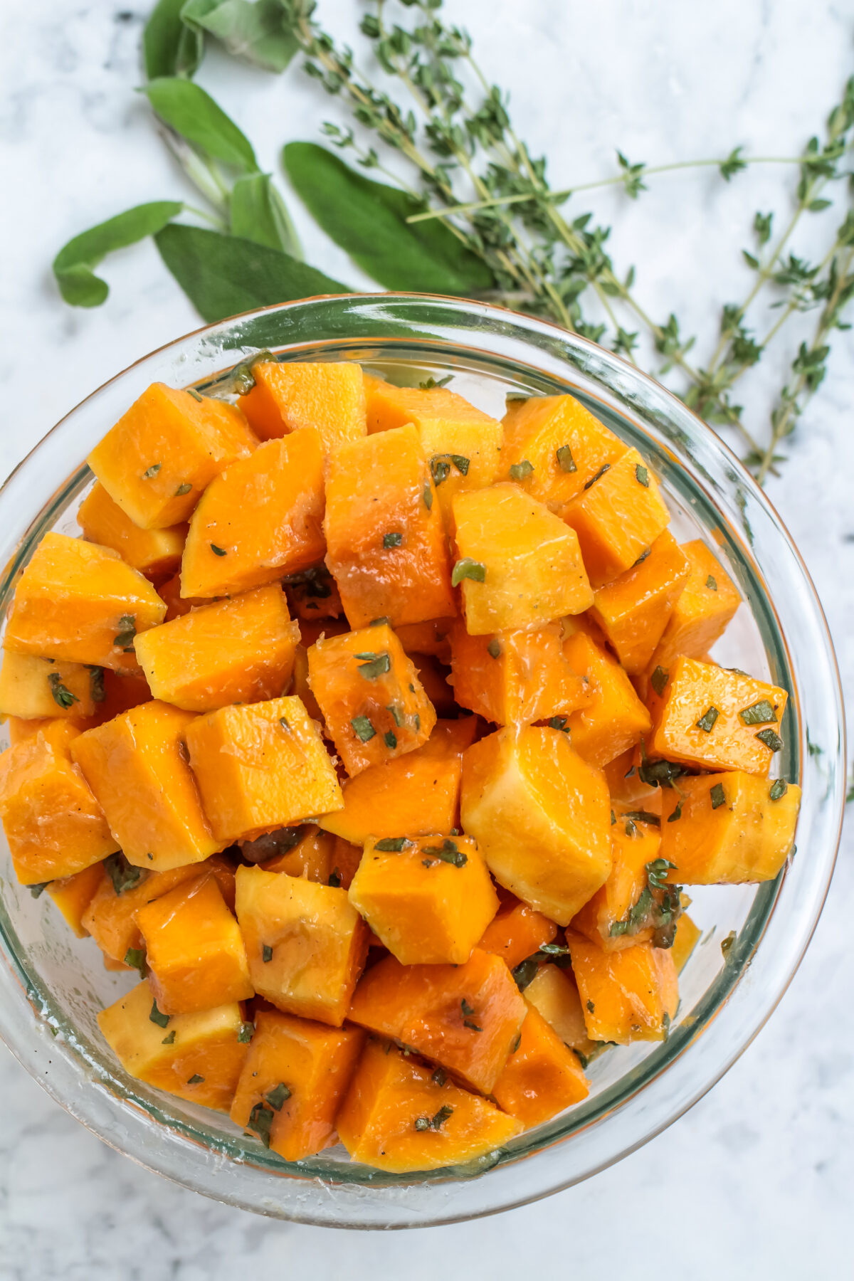 Squash cubes coated in butter mixture.