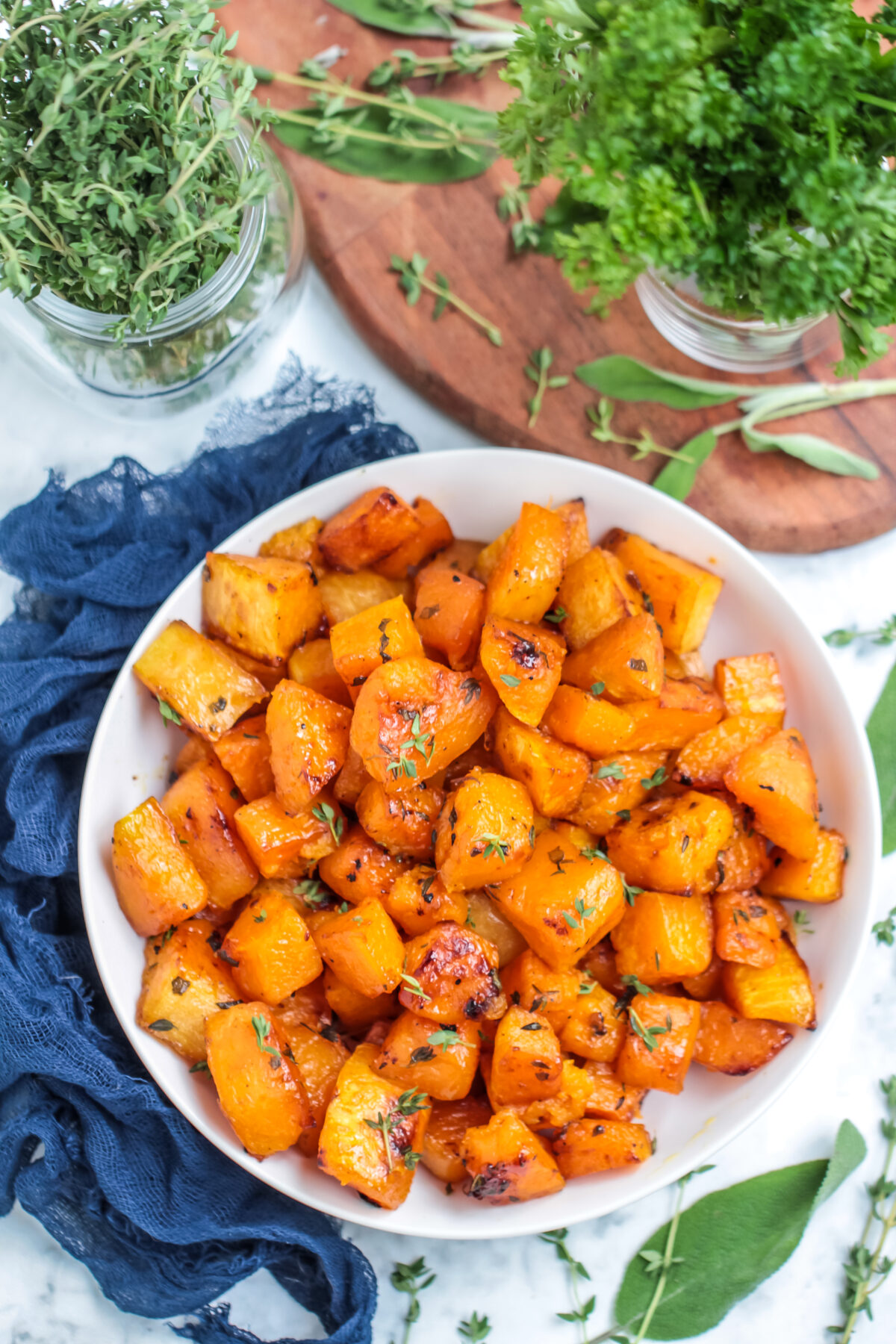 Roasted butternut squash with brown sugar and herbs is a tasty side dish for any fall menu. You will love this perfectly caramelized squash!