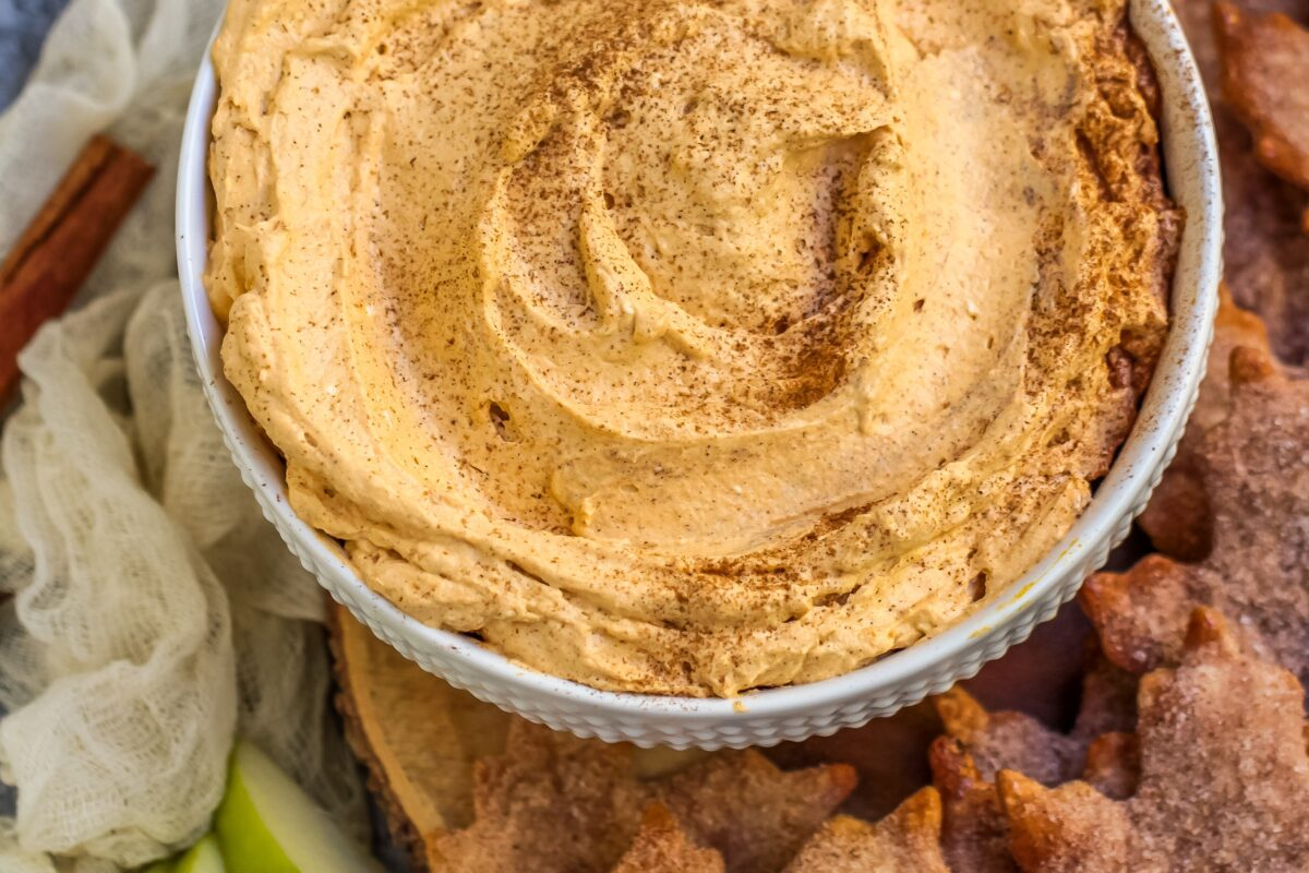 Pumpkin pie fluff dip that has all the flavours of a slice of pie. Served with cinnamon sugar pie crust chips, it's the perfect fall dessert!